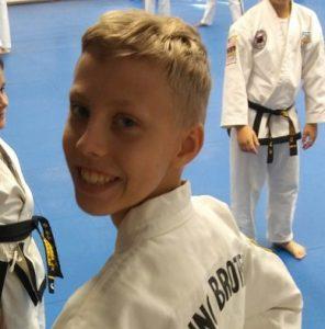 Son karate smiling boy